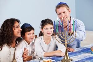 jewish-family-celebrating-hanukkah-menorrah